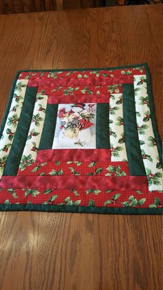 Sure to add that Holiday touch on your table. Log Cabin with Snowman in the center. Can be machine washed gentle cycle and Line Dryed or delicate cycle in dryer. Back is solid off white. Size is 18 X 16 Quilted Table Runners Christmas, Christmas Placemats, Christmas Runner, Table Runner And Placemats, Table Runner Pattern, Christmas Tree Quilt, Christmas Log, Christmas Quilt Patterns, Christmas Sewing
