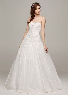 Angelic lace and breathtaking beaded appliques make this strapless wedding  dress that much more timeless and elegant! Strapless ball gown features  stunning ... 35bcda0cc607