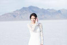 modest wedding dress with long lace sleeves and a tight skirt from alta moda. -- (modest bridal gown).