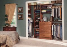 A Classic reach-in closet in Rustic Cherry, this solution easily ...