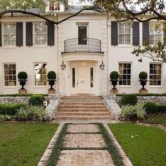 french house with beige shutters | White Brick Home, Traditional, home exterior, Jan Showers