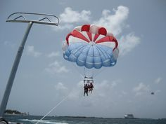 A Great Stirrup Cay parasailing excursion an exhilarating way to see this private island. A boat will take you out to sea from where you'll sail through the sky for a bird's-eye view of your surroundings. Bahamas Cruise, Cruise Port, Golf Driving Net, Outdoor Movie Screen, Parasailing, Out To Sea, Paradise Island, Water Slides, Birds Eye View