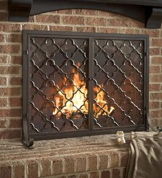 Moroccan inspired clover and star pattern glass backed fireplace screen or fire screen custom made in St Louis to fit a rectangular fireplace.