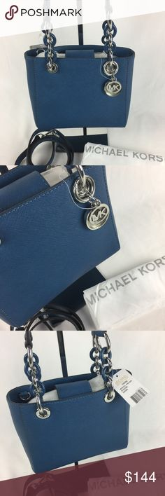 Michael Kors Cynthia Small North/South Satchel Condition: New with tags and dust bag  A sophisticated MICHAEL Michael Kors tote in saffiano leather. Polished feet. Magnetic tab at top line. Lined interior with 3 pockets and a middle zip compartment. Double handles and optional, adjustable shoulder strap (included!) . 9.5 x 4 x 8 inches.    Thank you for your interest! No Trades please. Michael Kors Bags Satchels