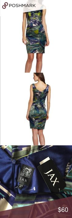 JAX Dress! NWT JAX Beautiful Dress New with tags! Size 6. Zipper in the back! Love the color pattern! Navy blue with tan and greens! Fully lined 97% polyester 3% spandex. Very high quality and comfortable! From Macy\'s. Lightly padded breast cups. 38.5 inches long. Bust measuring from under arm to under arm across the front 17.5 inches. Jax Dresses Midi