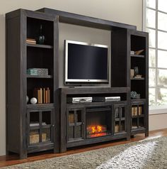 Large Black Wooden Tv Stand With Fireplace And Storage Also Shelves Plus Rectangle Led Tv On Laminate Flooring In Grey Living Room