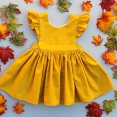 Cora Pinafore Dress in Mustard for baby toddler little girl long elbow sleeve co. - Cora Pinafore Dress in Mustard for baby toddler little girl long elbow sleeve cotton handmade button back warm cozy fall winter thanksgiving vintage inspired boutique Little Girl Fashion, Toddler Fashion, Toddler Outfits, Baby Outfits, Kids Fashion, Toddler Girls, Fashion Clothes, Fall Clothes, Toddler Dress
