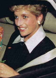 """Princess Diana Legacy. Princess Diana in a black dress with a large white collar, or could be a sweater with blouse underneath and skirt.  Circa 1993 or 1994. Princess Diana also wore this outfit: August 1994: Princess Diana on a private holiday at 'Martha's Vineyard' Island... might be this event, earrings look similar. But I think this is more likely: 13 May 1993 Princess Diana """"Charity Concert"""" Smith Square, London ..looks the same!!"""