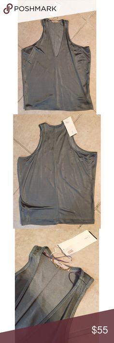 """✨RARE✨ NWT ZARA Silvered Olive Green V-neck Tank ♡ ZARA W&B Collection Silvered Muted Olive Khaki Green V-Neck Tank Top with a Snake-like textile pattern fabric - """"DELICATE GARMENT"""" label! Gold chain attached to origin tag. Super lightweight, soft breathable material! Great to pair with highwaisted jeans & shorts, skirts, etc. Great color for the summer/spring time with a feminine edge! Pair with cute bralettes! Never been worn as it still has original tags. Made in Morocco. 63% Acetate 37%…"""