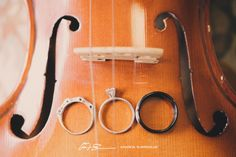wedding rings on violin, love the idea of incorporating a hobby/passion into wedding photography