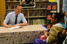 Neil Patrick Harris, an Albuquerque native, shares a moment with Valentina Garcia while signing his just-published autobiography. (Adolphe Pierre-Louis/Journal)