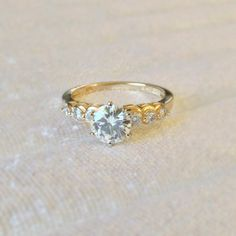 7.5mm Forever Brilliant Charles and Colvard Moissanite 7 Stone Engagement 14K Two-Tone Yellow and White Gold Ring 1.79 Carat Total Weight
