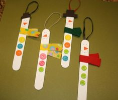 kreativ basteln kinder eisstiele knöpfe schneemänner weihnachten dekoideen