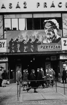 People walking past a movie theater. Photograph by Walter Sanders. Prague, Czechoslovakia, December 1947.