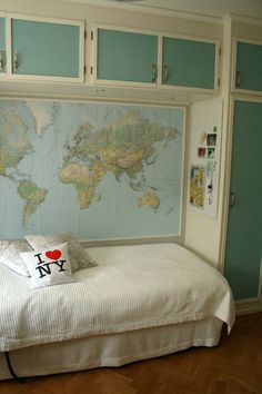 fun idea for living room with a sofa like this with a giant map of the world behind it with little pin-flags where the family has been ( doubles as a family-tree of sorts- or rather, where we all originated from )