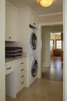 Laundry Room.. this would fit my layout. just need a cool light, fantastic rug and color on the walls