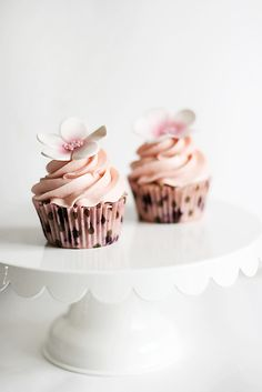 Gorgeously frosted, flower adorned Lemon Blueberry Cupcakes. #food #cooking #baking #dessert #cupcakes #wedding #lemon #blueberry