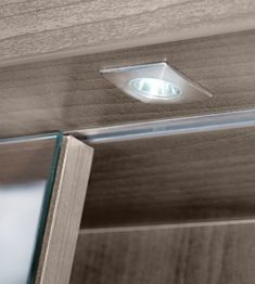 Sliding Bathroom Mirror Cabinet With Lights From Utopia Bathrooms.