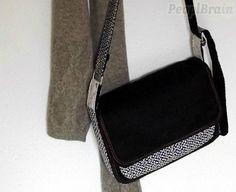 DIY Un sac à rabats. (https://fr.peoplbrain.com/tutoriaux/couture/coudre-un-sac-a-compartiment-zippe)