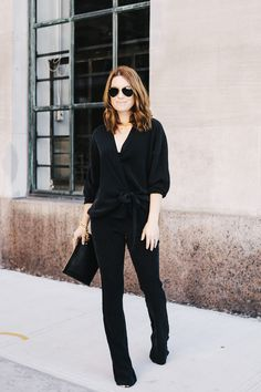 all black silk suited.