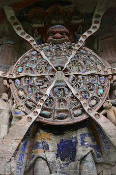 Six Realm Wheel of Rebirth - Baodingshan Buddhist Rock Carvings, Dazu. Picture by Steve Byrne
