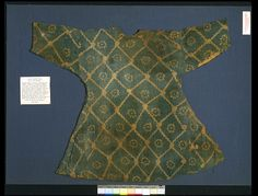 Tunic  Place of origin: Egypt  Date:500-700  Materials and Techniques: Plain woven linen or cotton, resist dyed  Museum number:1522-1899