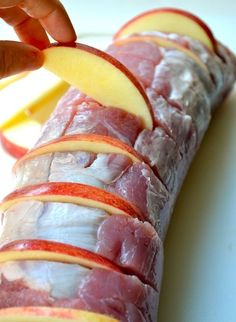 Cut slits in tenderloin, put apple slices into slits, drizzle with honey and apple juice and top with cinnamon and onion slices.  3-4 hours on low setting in the crockpot..