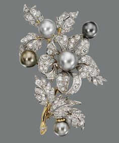 CULTURED PEARL AND DIAMOND BROOCH The floral spray set with 125 round diamonds weighing approximately 5.00 carats and accented with 5 cultured pearls in pale to medium gray, measuring approximately 8.4 to 10.7 mm., mounted in white and yellow gold.