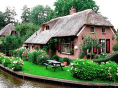 Giethoorn, Holland. Apparently there are no roads--just waterways, bike paths, and walkways.
