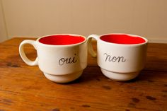 """For the ficklest of friends, we present our """"Oui ou Non"""" stackable mugs. Each piece sold by Young Alexander is hand-painted and made in the USA. Oui Ou Non, Coffee Talk, French Words, France, Home And Away, Hand Painted, Mugs, Nice Things, Nifty"""