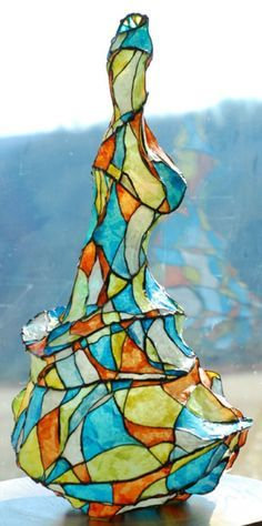 Looks like tissue paper and wire. Sharpie for color? I was just thinking about making something very similar to this!!!