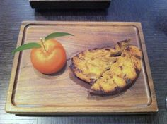 Meat Fruit - Mandarin, chicken liver parfait and grilled bread.