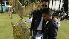 """Trash. On Mt. Everest. Tons of it:  Visitors look at art made from trash collected on Mount Everest, commissioned for the """"Mt. Everest 8848 Art Project"""" in Kathmandu on November 19, 2012."""