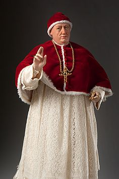 Pope Leo X, reigning pope at the start of the Protestant Reformation. One of the church's most corrupt pontiffs. Built St. Peter's Bascilica in Rome by selling indulgences. Has style, though: Camauro, pectoral cross, shoulder cape, rochette.