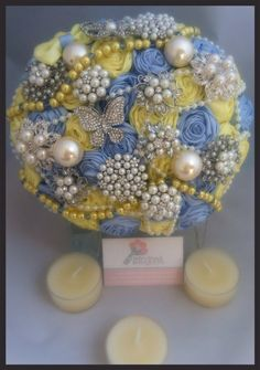 Yellow and blue brooch bouquet. Ribbon by Bellesbroochbouquets