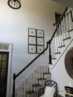 Banisters - white spindles with glossy black banister.  Love it, so clean.