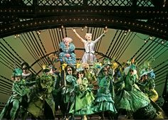 [UNITY-VARIETY]  Wicked the Musical.  This is an example of unifying a group of people using one color, but providing variety as well by changing the texture, size, cut, and shape of the garments.