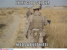 Awesome soldier with a cat with him