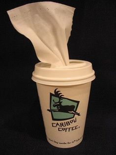 There's a handy new use for that coffee cup! Use it as an easy-access tissue box in your car. Fill the cup with tissues and pull each one through the hole in the lid.