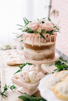 A beautiful naked drip cake topped with fresh flowers was the centerpiece of the dessert table for spa themed birthday party!