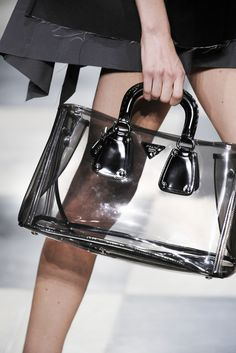 These plastic totes are, I'm told, the hottest things out of Italy by Armani & Versace.