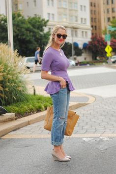Ladylike peplum top, ripped jeans, poiny wedges.