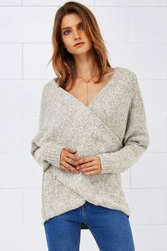 Obsessed.  not sure how much i can wear this in the south..  Cupshe Grin and Flare It Cross Plunging Sweater