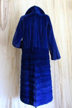 DESIGNER REVILLON COBALT BLUE MINK COAT   Measurements :: Bust: 36 - 44 / DropWaist: 40 / Sleeve: 24 / Across the Top of the Shoulders: 17 - 18 / Overall Length: 50 Fits size 8-10   Maker :: Revillon PARIS • LONDON • NEW YORK   Condition :: Near Mint!!! Blue Hoot is embroidered on the inside lining. Convo me for additional pics. Featured Model: Kacy Bryce    Whynaught Follow Us! @kimberlywhynaughtshop  Shop Whynaught Shop! www.etys.com/whynaughtshop  Shop More Vintage…