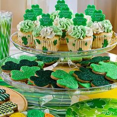 """Create a tower of Irish treats! Yum!  Stack two cake stands to make your cupcakes and cookies the """"pot o' gold"""" of the desserts table."""