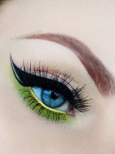 eye makeup: pop of color ( lime green ) + black winged eyeliner with negative-space detail