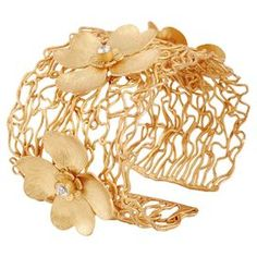 "Handcrafted 22k gold-plated cuff with floral accents.  Product: CuffConstruction Material: 22k Gold-plating and cubic zirconiaColor: GoldFeatures:  Handmade to orderMade in India Dimensions: 2"" HCleaning and Care: Gently wipe clean with a soft cloth and store in a jewelry box"