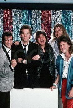 """Photo: Greg Kihn, Huey Lewis, Steve Perry, Jack Blades, and a friend pose for a photo at the 1985 """"Bammies"""", the Bay Area Music Awards, hosted every year since 1977 by BAM, a San Francisco music magazine. Lewis, Perry, and Blades won awards that night. March 23, 1985 San Francisco, California, USA"""