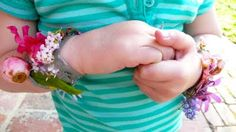A bracelet from nature - duct tape, sticky side out and add elements from your nature walk.