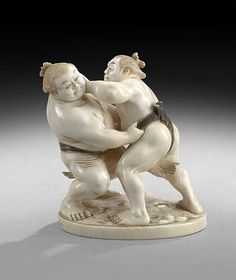 """Japanese Ivory Carving, late 19th/early 20th century, depicting a pair of sumo wrestlers, h. 3""""."""